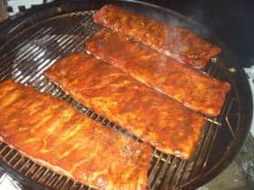 Four racks of ribs on a 26 inch Weber kettle