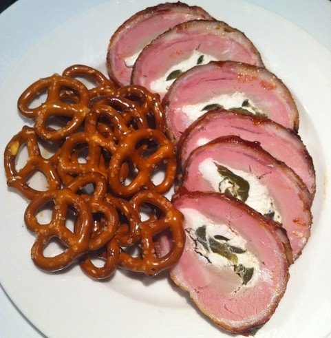 Bacon wrapped pork tenderloin stuffed with jalapenos and cream cheese